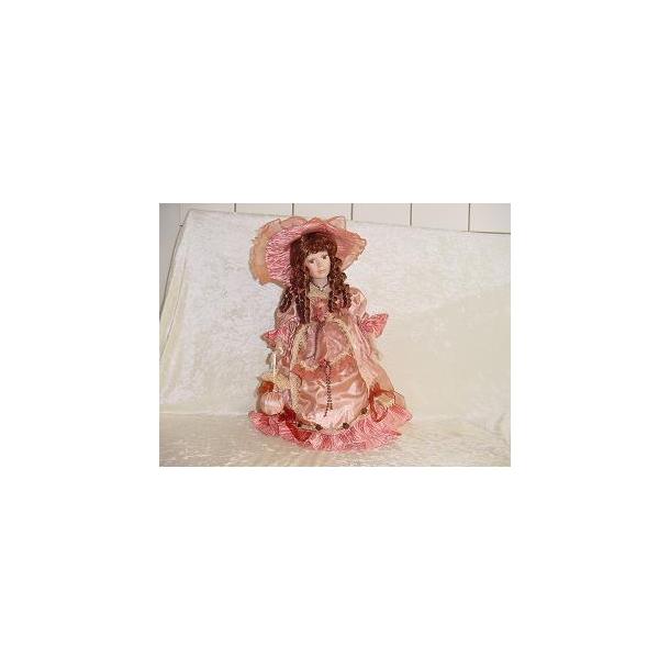 Porcelænsdukke rosa kjole.Brunt hår